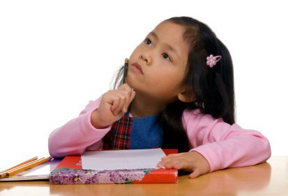 Young girl with pencil thinking hard